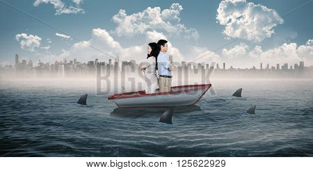 Couple with their backs to each other against sharks circling a small boat in the sea