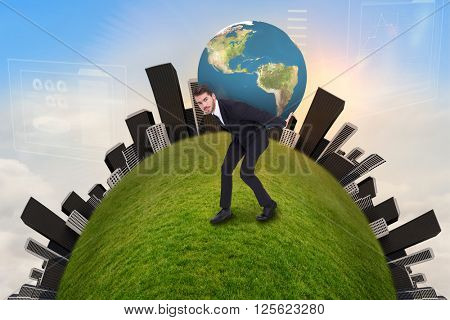 Businessman carrying the world against blue sky with white clouds