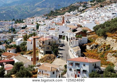 COMPETA, SPAIN - JULY 1, 2008 -View of the town with the The Assumption (La Asuncion) church tower to the centre Competa Malaga Province Andalucia Spain Western Europe, July 1, 2008.