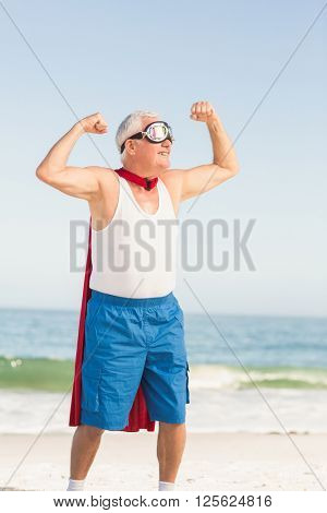 Senior man pretending to be a superhero on a sunny day