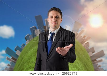 Handsome businessman holding hand out against scenic view of blue sky