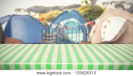 white and green tablecloth against empty campsite at music festival