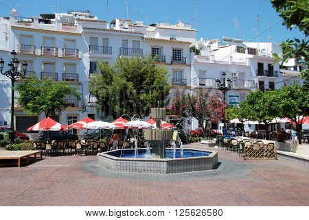 TORROX, SPAIN - JULY 1, 2008 - Fountain and pavement cafes in the town square Torrox Malaga Province Andalucia Spain Western Europe, July 1, 2008.