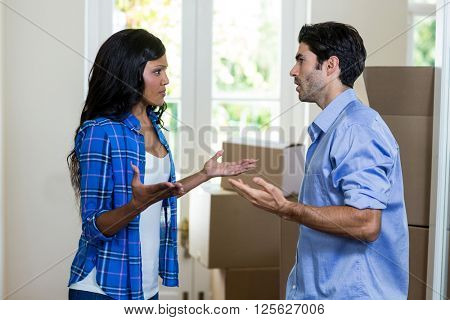 Young couple arguing with each other at home