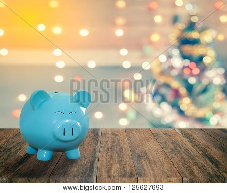 blue pig bank with Christmas background money and saving for celebration concept.