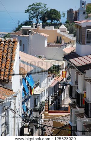 TORROX, SPAIN - JULY 1, 2008 - Elevated view along a narrow village street with the sea to the rear Torrox Malaga Province Andalucia Spain Western Europe, July 1, 2008.