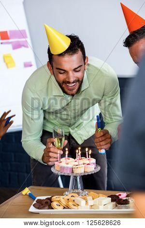 Man celebrating his birthday in office