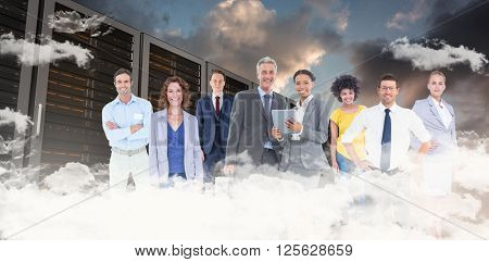Business team against blue and orange sky with clouds