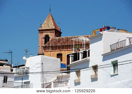 Townhouses with the church to the rear Torrox Malaga Province Andalucia Spain Western Europe.