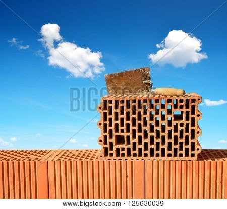 Building a red brick wall. Bricklaying work