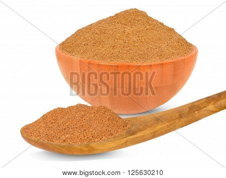 spice nutmeg in a bowl isolated on white background