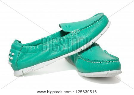 The photo shows the moccasins on a white background
