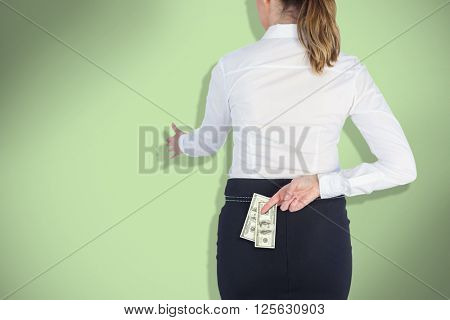Businesswoman offering handshake with fingers crossed behind her back against green background