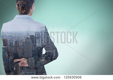 Businesswoman with fingers crossed behind her back over white background against blue background