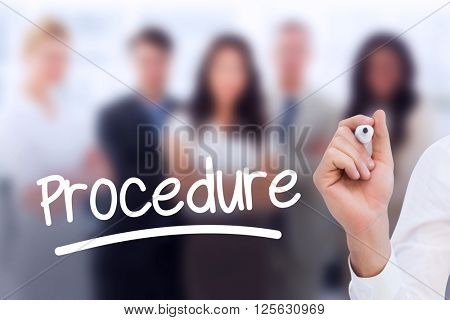 Mid section of businessman writing with marker against business team smiling at camera with arms crossed
