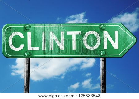 clinton road sign on a blue sky background
