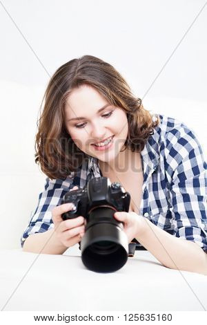 Young and attractive teenage girl with a dslr camera. Hobby and photography concept.