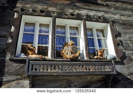 Window of wooden house in Zermatt Resort, Canton of Valais, Switzerland
