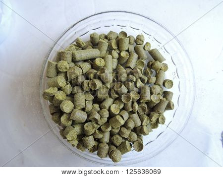 Granulated hops in the transparent glass container