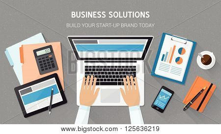 Business technology and freelancing concept office desktop with laptop tablet files and businessman's hands typing top view