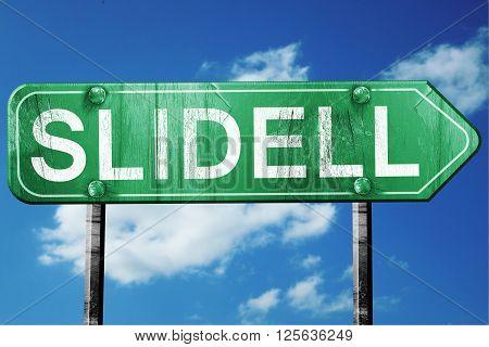 slidell road sign on a blue sky background