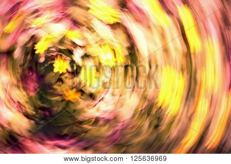 blurred abstract colored background with yellow flowers