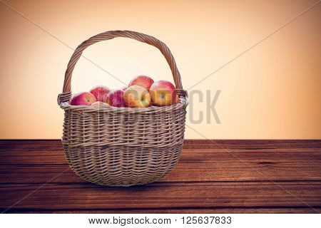Basket of apples against orange vignette