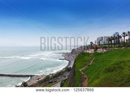 ocean shore and road at the big city