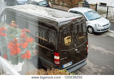 PARIS FRANCE - DEC 10 2015: UPS United Parcel Service van delivery brown ups van after dlivering the on time delivering package parcel