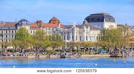 Zurich, Switzerland - 10 April, 2016: view on Utoquai quay with the Zurich Opera building (German: Opernhaus Zurich) in the background. Zurich is the largest city in Switzerland and the capital of the Swiss canton of Zurich.