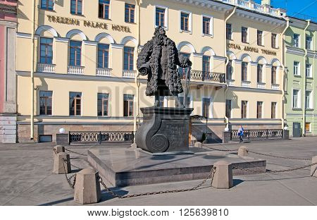 SAINT - PETERSBURG, RUSSIA - APRIL 13, 2016: Domenico Trezzini Sculpture on The Trezzini Square. On the background is Trezzini Palace Hotel. Domenico Trezzini was first architect of Saint-Petersburg