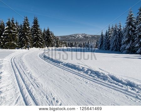 Sunny day on winter mountains with groomed cross-country trails, Jizera Mountains, Czech Republic