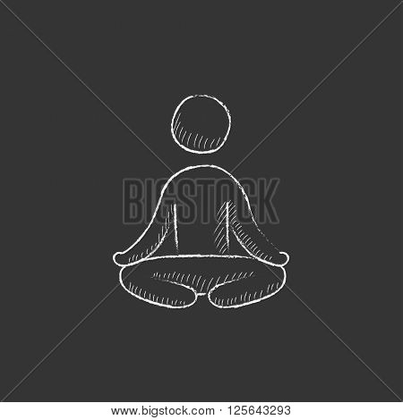 Man meditating in lotus pose. Drawn in chalk icon.