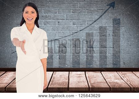 Smiling dark haired model with classy dress holding out her hand against blue data