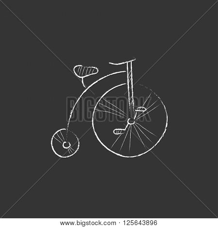 Old bicycle with big wheel. Drawn in chalk icon.