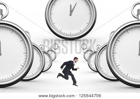 Geeky young businessman running mid air on a white background with clocks