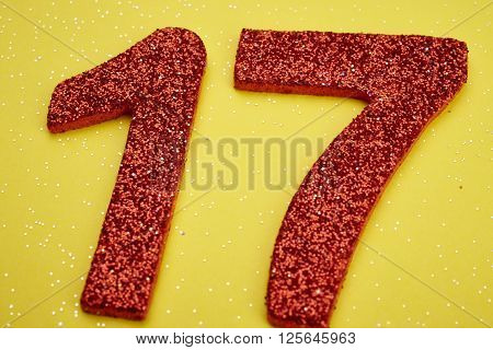Number seventeen red color over a yellow background. Anniversary. Horizontal