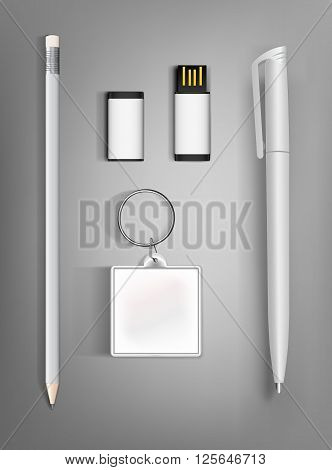 Collection of corporate identity presentation templates mock up with a pencil pen flash drive and key ring. Ready for your design on gray background.