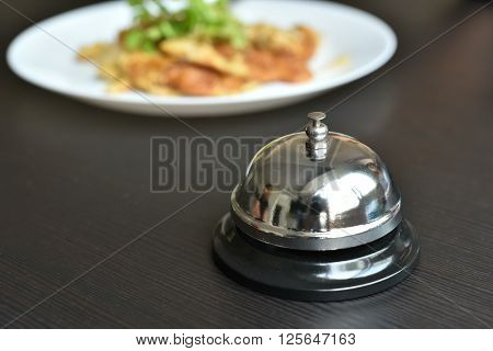 service bell on wooden table in restaurant.