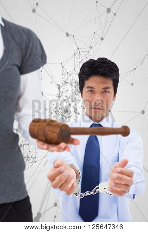 Woman holding a gavel and scales of justice against black lines on grey background