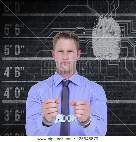 Handsome businessman wearing handcuffs against fingerprint on circuit board