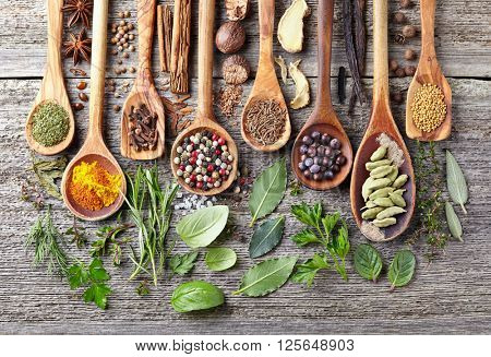 Spices and herbs on a wooden background