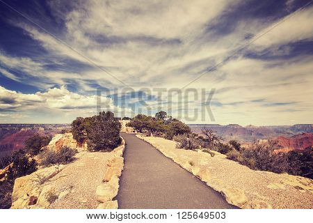 Vintage Toned Path To The Grand Canyon South Rim Viewpoint.