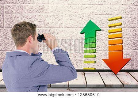 Businessman using binoculars against a stone wall