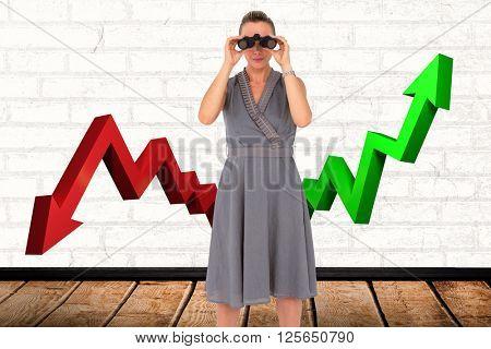 A businesswoman looking through binoculars against a white wall