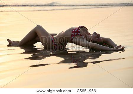 The beautiful girl on a coast of ocean