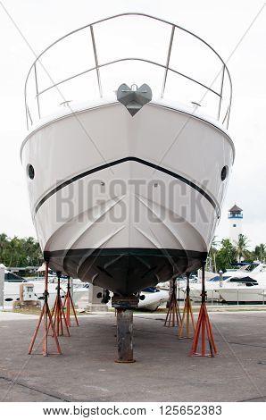 Small motorboat waiting for a maintenance at a shipyard