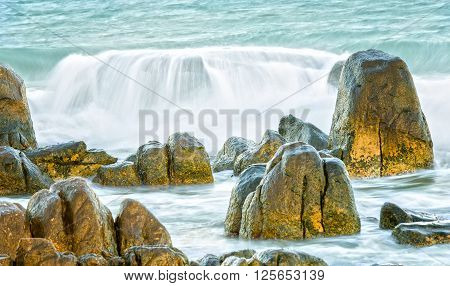 Waves swept stunning reefs tidal power high water flooded creating waves hit rocks to create amazing beauty nature and also attack roll it when angry if human nature who destroy nature