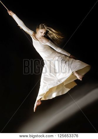 Attractive Dancing Woman  On Rope