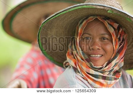 CHIANG MAI PROVINCE, THAILAND- CIRCA JULY, 2005 :  2005, In the province of Chiang Mai north Thailand. During the monsoon in july, a woman is taking a break in the paddy fields